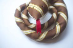 snake tie - Turn a tie into a child's toy. This free sewing pattern is cheap and easy to make.
