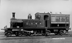 LSWR 733 The Bug, 4-2-4 which was Drummond's personal transport and could reach 85 mph.. (Locomotive Publishing Co). Its saloon ended up as a garden shed in Swanage.