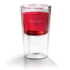 HALF-FULL GLASS - Is your glass half full or half empty? If you're like most people, you're never quite sure. But this clever seven-ounce glass reminds you that Half Full is where you'll always find refreshment. Double-wall borosilicate glass. www.cubiclelife.com