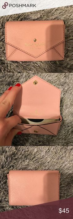 Kate Spade Card Holder Card holder in great condition - logo a little faded! Perfect size to hold multiple credit cards and cash or you can use as a fashionable business card holder! kate spade Accessories Key & Card Holders