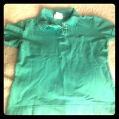 Ladies Lacoste polo. Size 36/6 Sea foam green polo top. Pic #1 depicts the color best. Size 38 or a size 6 in ladies Lacoste Tops