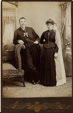 wedding portrait featuring a slouching groom and an austere bride. The wedding couple are both adorned with flowers. Vintage Wedding Photos, Vintage Photos, Couple Portraits, Wedding Portraits, Black Wedding Gowns, Black Bride, Victorian Gothic, Wedding Couples, Wedding Bouquets