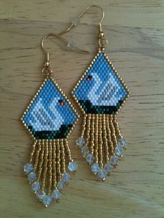 Delica Seed Bead Swan Earrings. Beautifully accented with size 11 gold seed beads. The fringe is finished with 4mm Swarovski Crystals.    The