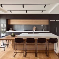 black is the new white in kitchen cabinets this color looks great accented with copper tones. Black Bedroom Furniture Sets. Home Design Ideas