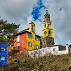 """Portmeirion village is a tourist village in Gwynedd, North Wales designed by Sir Clough Williams-Ellis. The village is located in the community of  Penrhyndeudraeth, on the estuary of the River Dwyryd, 2 miles (3.2 km) south east of Porthmadog, and 1 mile (1.6 km) from Minffordd railway station. Portmeirion has served as the location for numerous films and television shows, and was """"The Village"""" in the 1960s television show """"The Prisoner""""."""