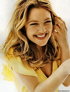 Drew Barrymore smiling with her whole face. Adorable. A child actor who's survived and flourished as an adult. Her extreme delight is always great to watch on film.