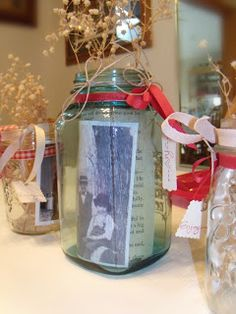 Mason jars as table centerpieces. Old photos, ribbon, twine, tags & old book pages. She Loves To Make Art