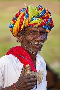 A farmer wearing traditionally brightly coloured turban in the dry state of Rajasthan, India, Asia