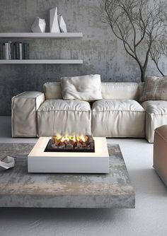 A Pillow style sofa, Concrete Coffee Table w/ fire pit and a tree.......Classy and contemporary......terrific!