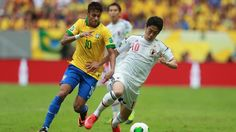 BRASILIA, BRAZIL - JUNE 15: Neymar of Brazil competes with Shinji Kagawa of Japan during the FIFA Confederations Cup Brazil 2013 Group A match between Brazil and Japan at National Stadium on June 15, 2013 in Brasilia, Brazil. (Photo by Scott Heavey/Getty Images)
