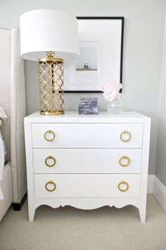 White and Gold nightstand would be perfect in a nursery. Love that you can find any white dresser and update with gold hardware. White And Gold Nightstand, Dresser As Nightstand, Nightstand Ideas, Small Dresser, White Dressers, Vintage Nightstand, Dresser Furniture, Furniture Handles, Dresser Knobs