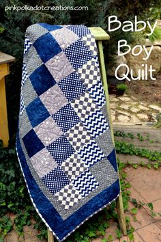 A simple Baby Boy Quilt to piece together and to quilt. It is simply blocks sewn together with a couple of borders to finish it off!