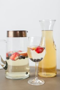 Fourth of July signature drink | peach champagne punch with strawberries and blueberries #LetsCelebrate #MarthaCelebrations