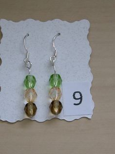 Sterling Silver earrings with glass crystal beads in brown, peach and green.