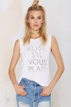 """You're always gonna need another glass of rosé, just sayin'. This white tank has """"Rosé S'il Vous Plaît"""" in a gray ombré print, ribbing at armholes and neck, and a loose fit. =="""
