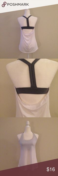 GapFit Workout Tank Perfect for Barre or the gym! Built in gray sports bra. Has slots for the padding but I took them out bc they kept bunching while laundering. GAP Tops Tank Tops