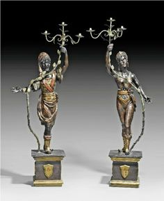A pair of Baroque style wooden blackamoors as candelabra. Venice, 19th Century