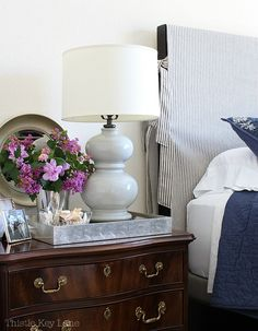 A headboard slipcover is a quick solution when updating a bedroom. See how to make a simple headboard slipcover with ticking fabric. #slipcovers #slipcoverheadboard #slipcoverideas #headboardideas #tickingslipcover