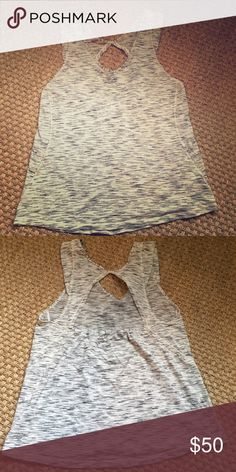 Lululemon white tiger space dye tank flutter sz 10 RARE/HTF lululemon athletica white tiger space dye knit tank with flutter sleeve and cute pleating in back. EUC- no signs of wear – washed but never dried. Smoke free and cat free home… No trades. See matching bang buster headband listed separately lululemon athletica Tops Tank Tops
