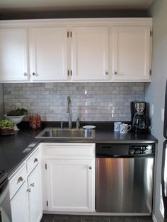 Suzie: Freckles Chick - Beautiful kitchen with kitchen cabinets painted Behr Ultra White, ...