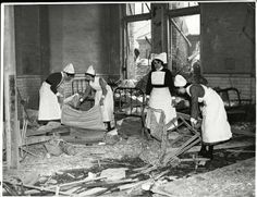The aftermath of a bombing at a hospital in November, 1940 Nurses doing the cleaning up....