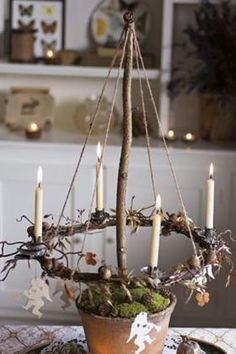 Candle wreath suspended over garden pot. Place several along the festive table f… - Candle wreath suspended over garden pot. Place several along the festive table f… Candle wreath suspended over garden pot. Place several along the festive table f… Natural Christmas, Noel Christmas, Christmas Is Coming, Rustic Christmas, Winter Christmas, Vintage Christmas, Christmas Crafts, Yule Crafts, Christmas Tables