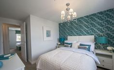 Interior Designed Modern Guest Bedroom using aqua, teal and chalk white colour scheme - love those metallic teal lamp shades and the leaf wallpaper. Bovis Homes 2015