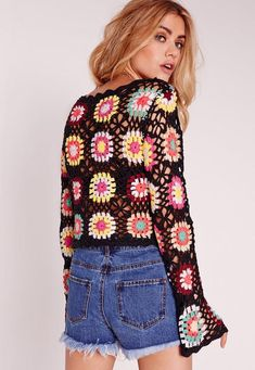 Channel hippie chic for spring this year in this lush little long sleeved jumper. The multi flower pattern and long sleeves makes this a wardrobe staple - boho style! The see through crochet piece is perfect for throwing on with little shor...