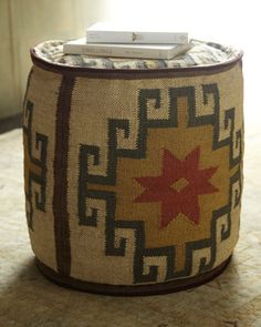 These would be cute for George to sit on and play his video games in his room.Kilim Ottoman at Horchow.