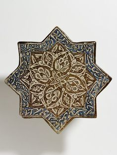 Tile Place of origin: Kashan, Iran (made) Date: early 14th century (made) Artist/Maker: unknown (production) Materials and Techniques: Fritware, painted with lustre over the glaze Museum number: 351-1896