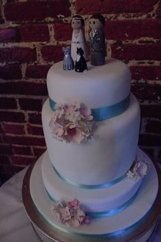 Pink, duck egg, turquoise, blue wedding cake with wooden peg cat toppers diy. this was my wedding cake, absolutely loved it!