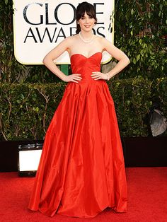 Zooey Deschanel's beautiful red Oscar de la Renta gown was the perfect match for a classically elegant strand of pearls. We love this look!