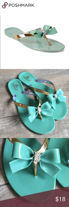 """NIB Nomad Footwear green and gold bow jelly sandal NIB Nomad Footwear green and gold bow jelly sandal. The company calls the sandal """"green,"""" but it's actually a pretty mint color. Rhinestones dot the center of bow. New, never worn. Nomad Footwear Shoes Sandals"""