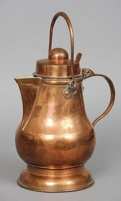 A 19th century copper water jug Of baluster form, with carrying handle, hinged cover, loop handle and spreading foot, variously stamped JPW and dated 1882. 34 cm high.