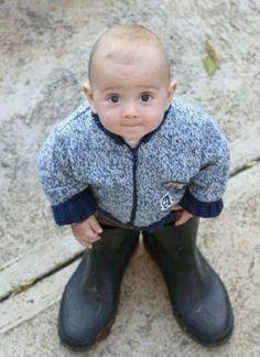 LIttle boy in big shoes