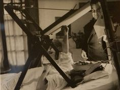 Frida Kahlo painting in her bed in her house, Mexico City. Frida