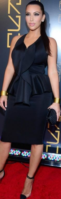 Who made Kim Kardashian's black woven clutch handbag, jewelry, clear ankle strap pumps, and black ruffle dress that she wore in New York on April 23, 2012?