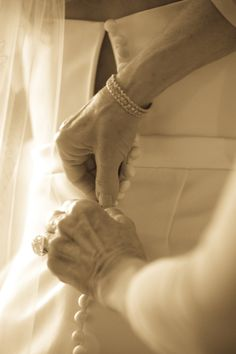 A great detail shot of my mom fastening me into my dress.