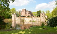 Homes with moats – in pictures