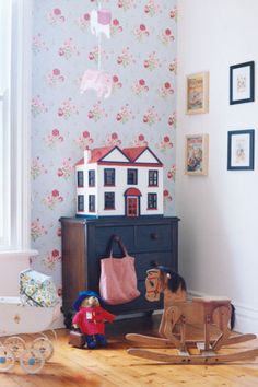 vintage dollhouse and small rocking horse