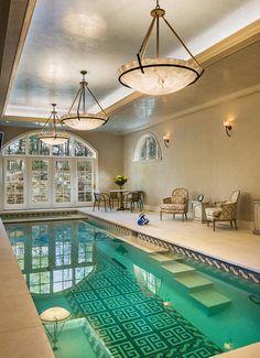 Wonderful indoor pool design with Mediterranean style and chandelier