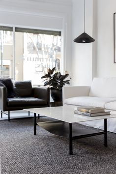 The Louis sofa was designed for Project 82 back in 2016 by cm studio.  Shown here in buttersoft Olive green leather (chair) and in white linen along with their Harry Coffee table in marble.  #interiordesign #moderndesign #coffeetable #livingroominspo #shopinterior #linensofa #simpledesign #designerfurniture #leathersofa #masculineinteriordesign #mancave #coastalinteriors #marblefurniture #whitemarble #refindedfurniture