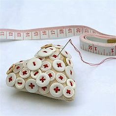 I love a GREAT pincushion.. show off your fancy buttons!