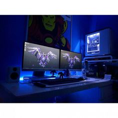 This white desk setup with dual monitors immediately caught my eye. And yes, also the gigantic Iron Man poster, haha. The main focus, of course white, combines really well with the blue LEDs. http://awesomedesksetup.com/dual-monitor-white-desk-setup/