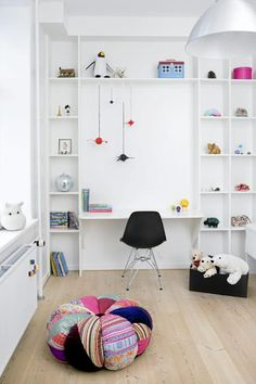 This white kids desk space is so minimalist and cool. Love how the shelves are styled too.