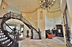 Traditional Staircase with High ceiling, Hardwood floors, Wall sconce, Crown molding