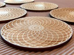 Engraved and cut geometry wooden coasters set by InvenioCrafts, €16.00