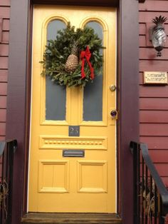 red (brick or not) house with yellow door or yellow wood house with red door