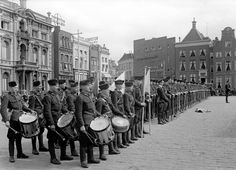 Men of the Dutch Labor Service on the 'Grote Markt' in Groningen, The Netherlands. On the left is the W.A. headquarters 'het Scholten-huis'. In the Scholten huis many innocent Dutch civilians were tortured or killed.