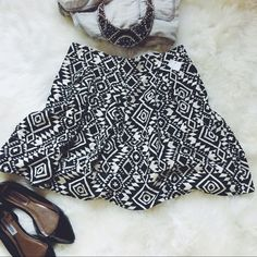"""Xhiliration Black + White Tribal Print Mini Skirt Cute, flirty and tribal print...what's not to love? Adorable pattern with the length hitting mid thigh (based on 5' 6.5"""" height), so not """"super mini"""". Brand new. Tags torn but still attached. Perfect condition! Xhilaration Skirts Mini"""